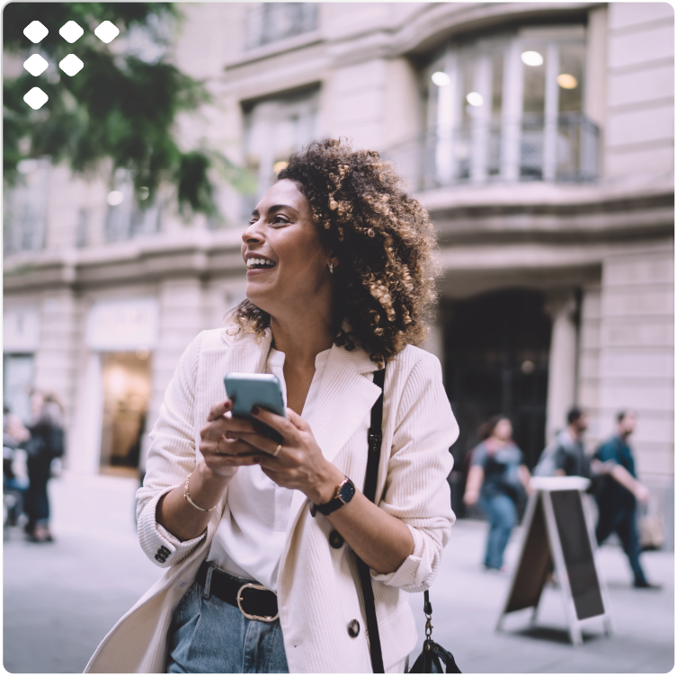 Smiling woman with mobile using travel chatbot.